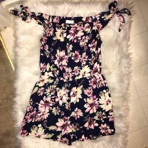 Dresses & Skirts - Cute floral/navy romper.  Great condition.  Sz L